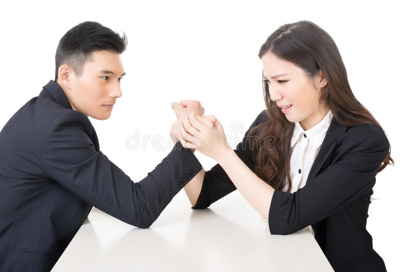 Business arm wrestling. Arm wrestling challenge between a young business men and woman, closeup portrait on white background stock photography