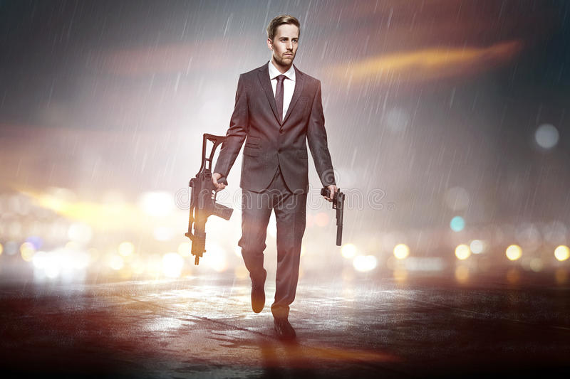 Business as usual. Business man with two weapons stock photos