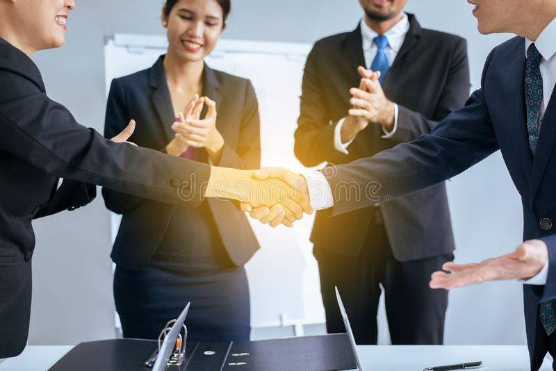 Business asian team people shaking hands after finishing up meeting in conference room royalty free stock image