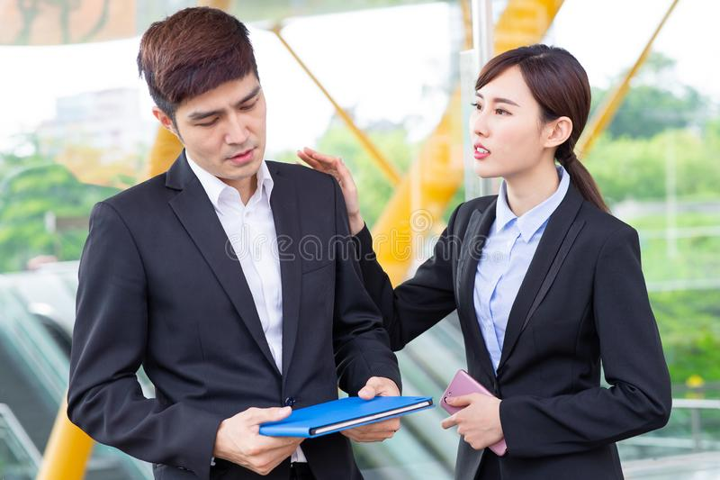 Businesswoman console her colleague stock image