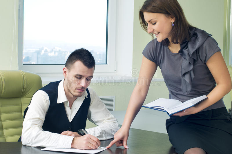 Business assistant with boss in office interior. Business assistant working with boss in office interior royalty free stock images