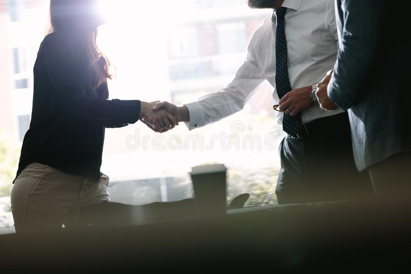 Business associates shaking hands after a deal. In meeting. Business people hand shake and greeting each other after an agreement stock photos