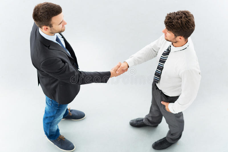 Business associates shaking hands royalty free stock images