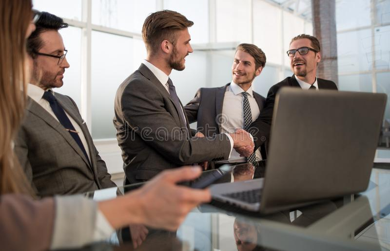 Business associates shaking hands in office stock images