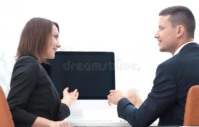 Business associates talking at a Desk. royalty free stock photo