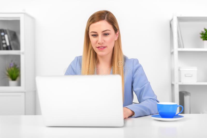 Business attractive woman working on laptop at workplace or at home. royalty free stock images