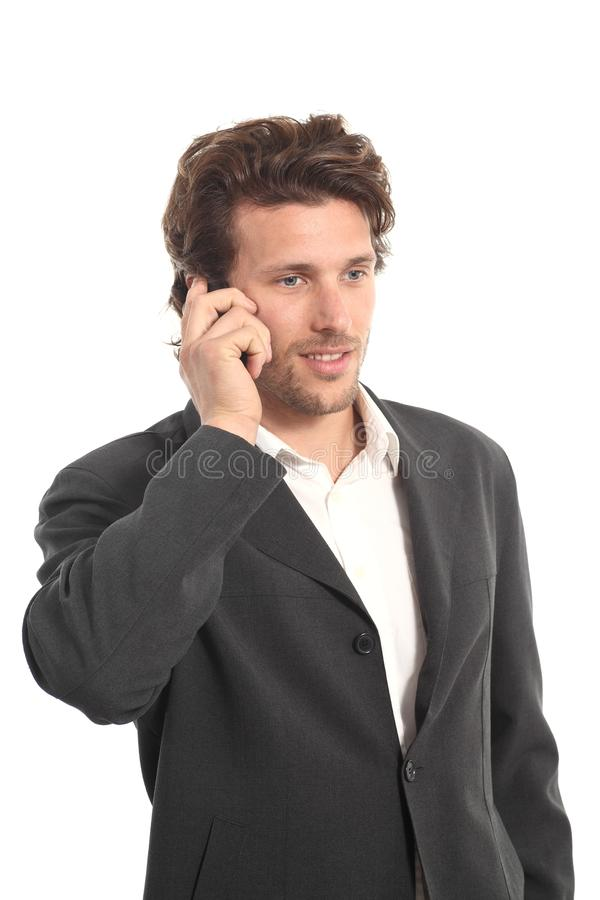 Business attractive young man with a phone stock image
