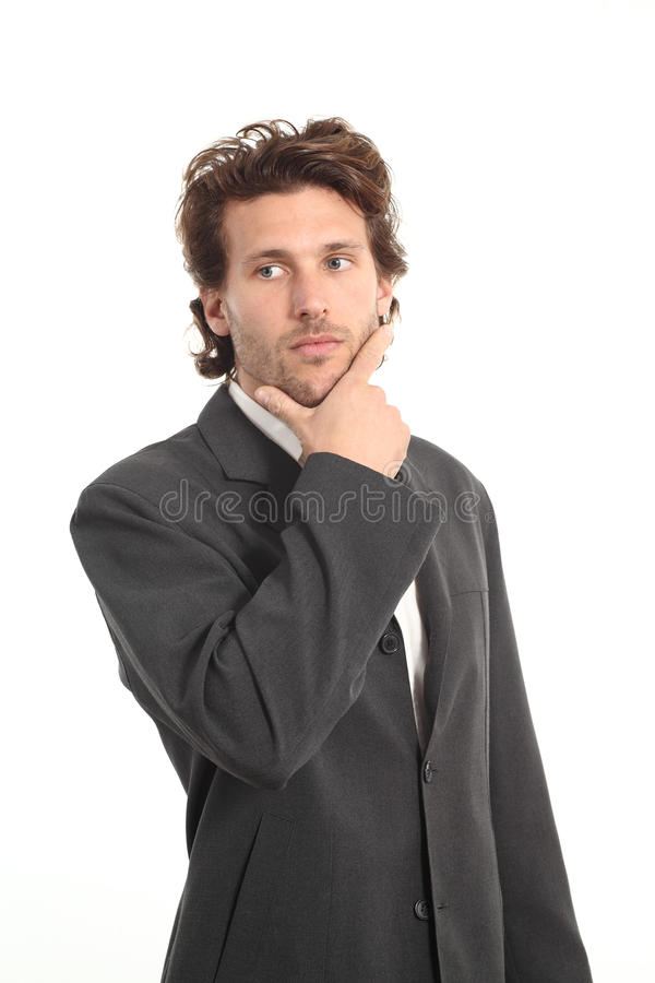 Business attractive young man thinking with a hand on chin royalty free stock photos