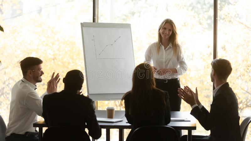 Business audience applaud happy female presenter thank for conference seminar stock image