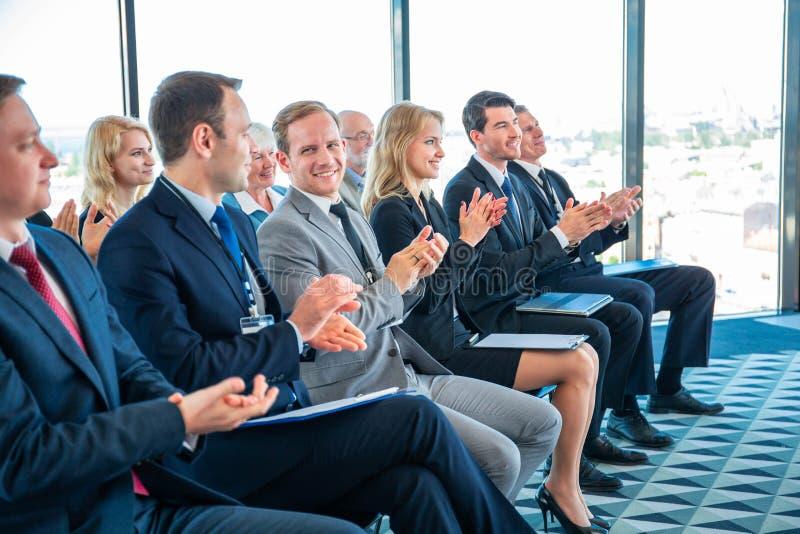 Business audience applaud at training stock photos