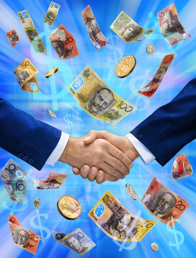 Business Australian Money Handshake Deal. Two businessmen shaking hands with Australian money raining down royalty free stock photo