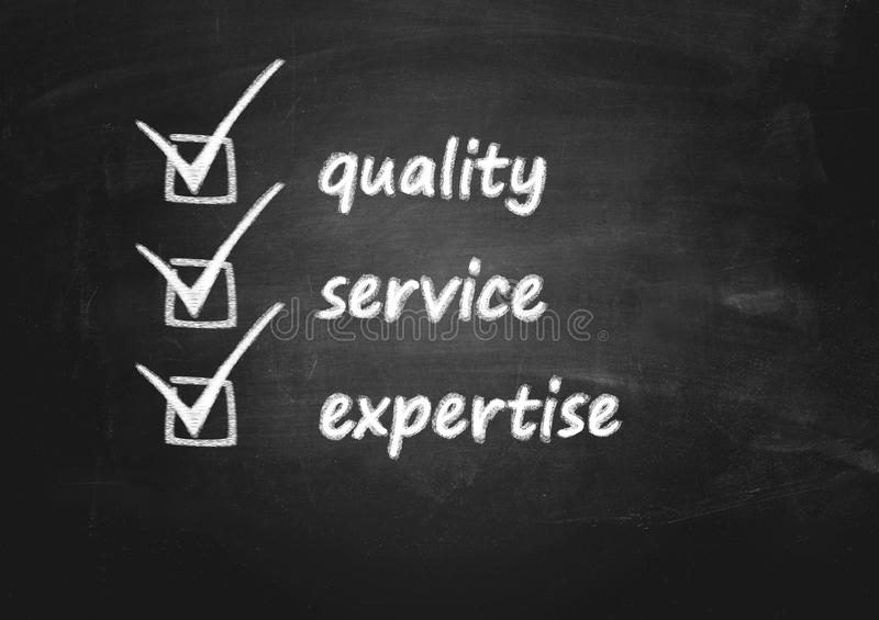 Business background concept for quality, service and expertise. Concept for quality, service and expertise on plain blackboard background stock photos