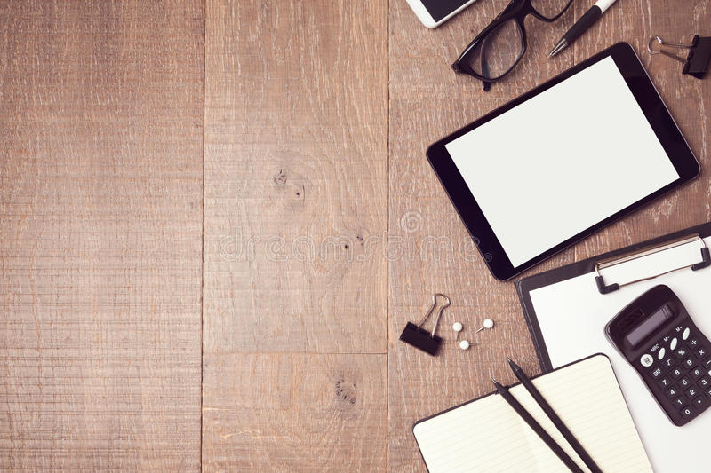 Business background with digital tablet and office items. View from above. Business background with digital tablet and office items royalty free stock photography