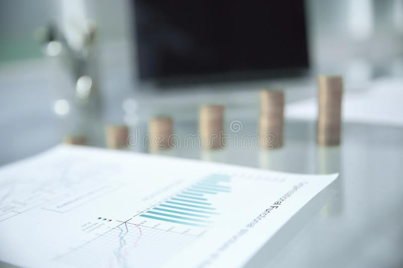 Business background. financials and stacks of coins on the office Desk. Photo with copy space royalty free stock photos