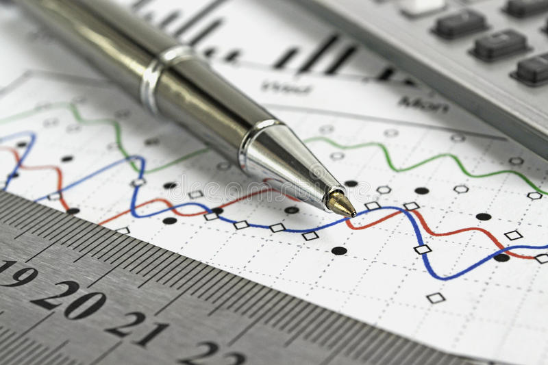 Business background. With graph, ruler, pen and calculator stock photo