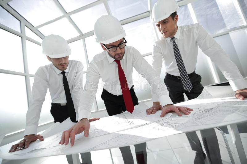 Group of architects look at the sketches for the new project.start-up royalty free stock photo
