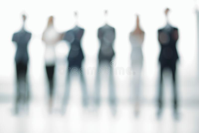 Business background.a group of business people standing in the o. Ffice.photo with copy space royalty free stock photography