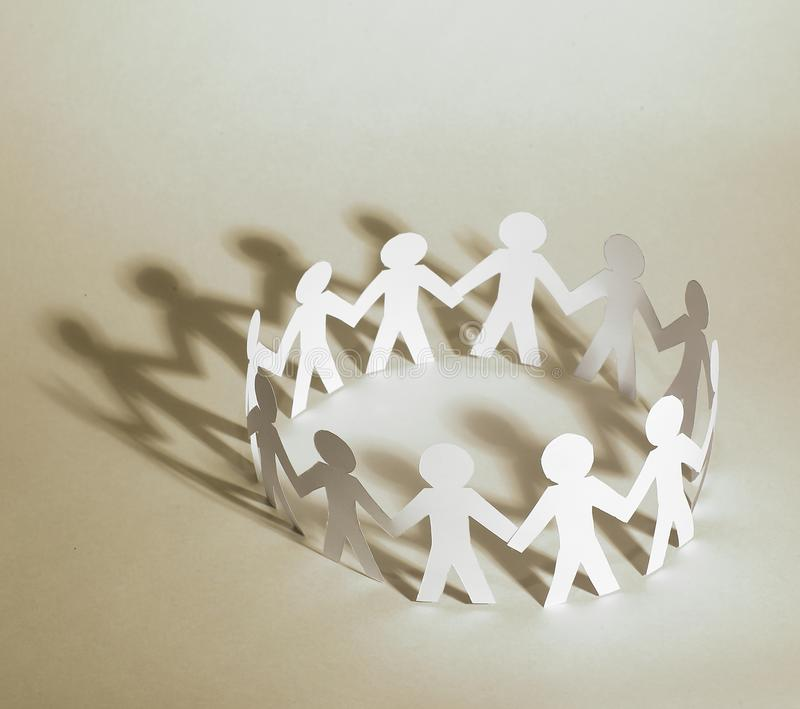 Business background.team paper men standing holding hands. stock photo