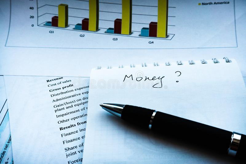 Business balance, income statement financial analyze money. Income statement financial report with pen. Financial analysis - business plan with chart, finance stock images