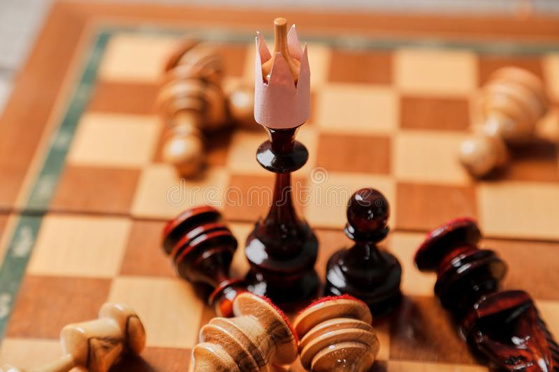 Business battle and strategy. Business game, leader and competition concept. Chess king and losing pieces.  royalty free stock image