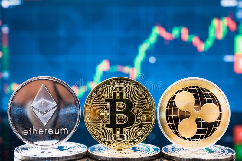 Business bitcoin, ethereum and XRP coins currency finance money. On graph chart background royalty free stock photography