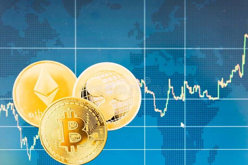 Business Bitcoin, ripple XRP and Ethereum coins currency finance. Money on graph chart background royalty free stock photo