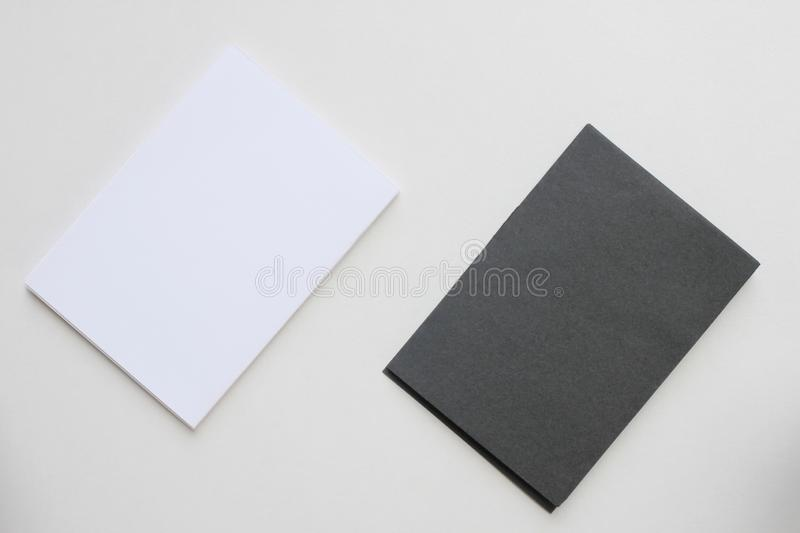 Business blank black and white card placed on the desk top view royalty free stock photography