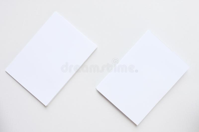 Business blank white card placed on the desk top view stock photos