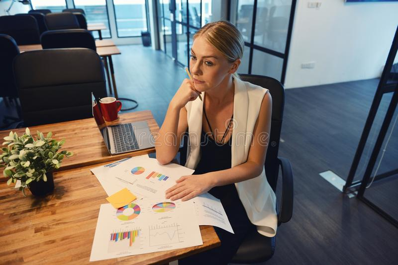 Business blonde girl thinking about work royalty free stock image