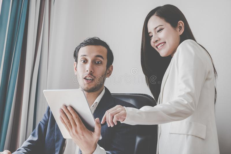 Business boss happy shocking wow to secretary business report stock images
