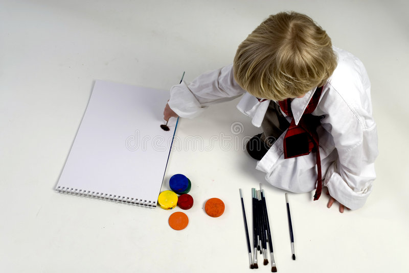 A business boy is painting. A empty painting to write on royalty free stock images