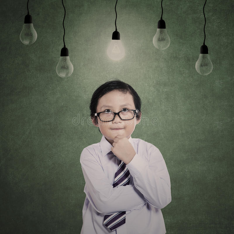 Download Business Boy Thinking Under Lamps Stock Illustration - Image: 33265261
