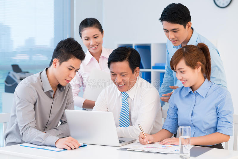 Business brainstorming. Image of a business command working at the office together royalty free stock photo