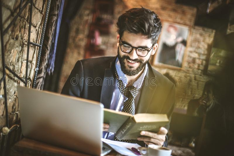 Business break is good time for education. Close up. Business break is good time for education. Close up image of businessman working stock photo