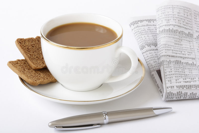 Business breakfast. Composition: coffee, newspaper, fountain pen royalty free stock image