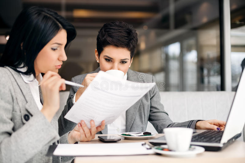 Business briefing. Two businesswomen consulting on meeting royalty free stock images