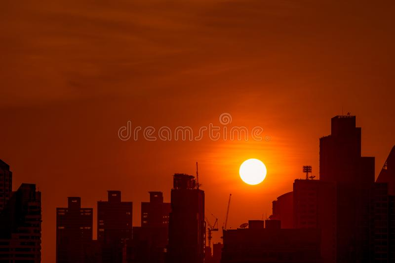 Business building in downtown at dusk with beautiful sunset sky. Silhouette of condo and apartment in the evening. Cityscape stock images