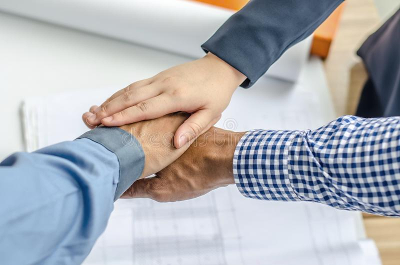 Business, building, partnership, gesture , stacking hands express their teamwork and cooperation stock photo