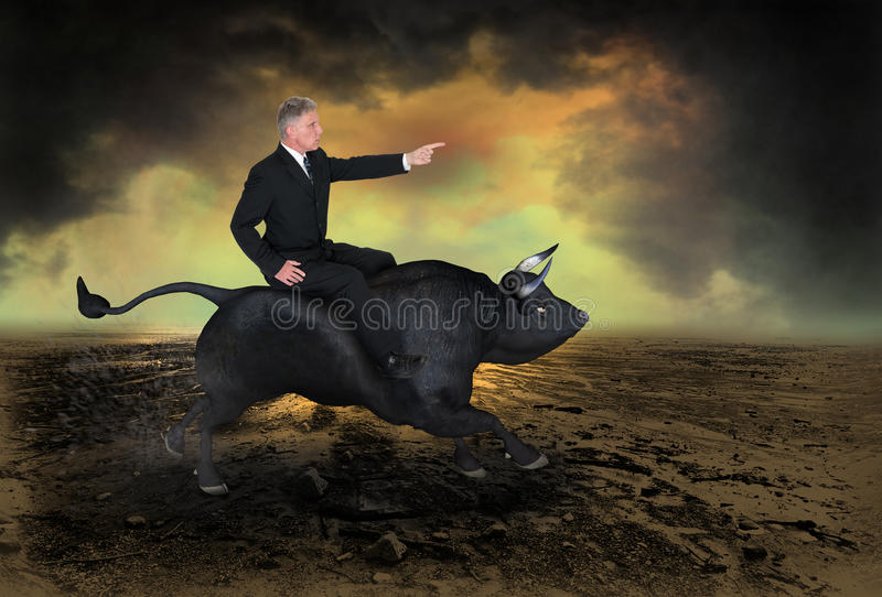 Business Bull Market Wall Street Concept. A businessman is riding a charging bull in a concept for business and a bull market on wall street. Image also has royalty free stock images
