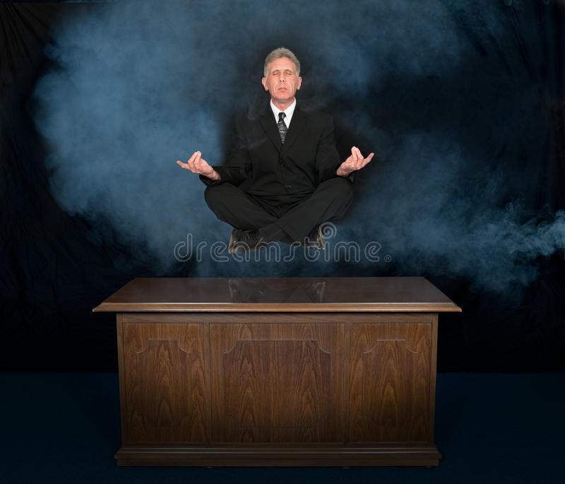 Business, Businessman Zen, Thinking, Meditate. A businessman floats in the air as he thinks about business, success, his career, making money, and profit royalty free stock photos