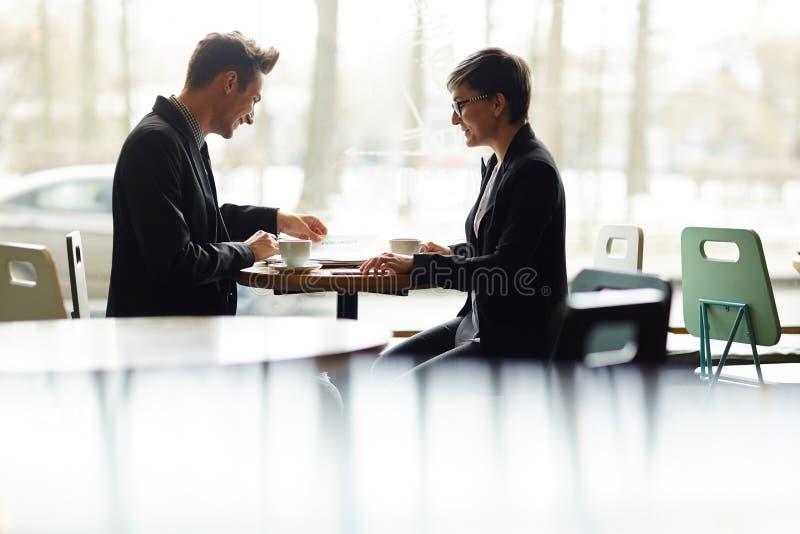 business cafe meeting arkivfoton