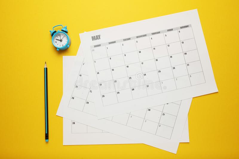 Business calendar, pencil and clock. Date reminder, office schedule royalty free stock images