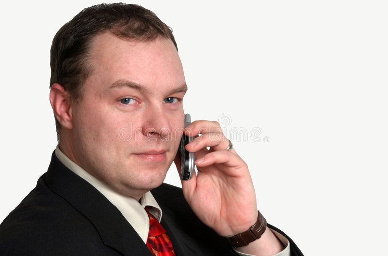 Business Call. A business man talking on the cell phone royalty free stock image
