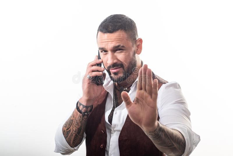 Business call. Man well groomed rich fashionable macho. Clothes and accessories. Fashion macho. Mobile conversation. Bearded guy white background. Mafia boss stock photo