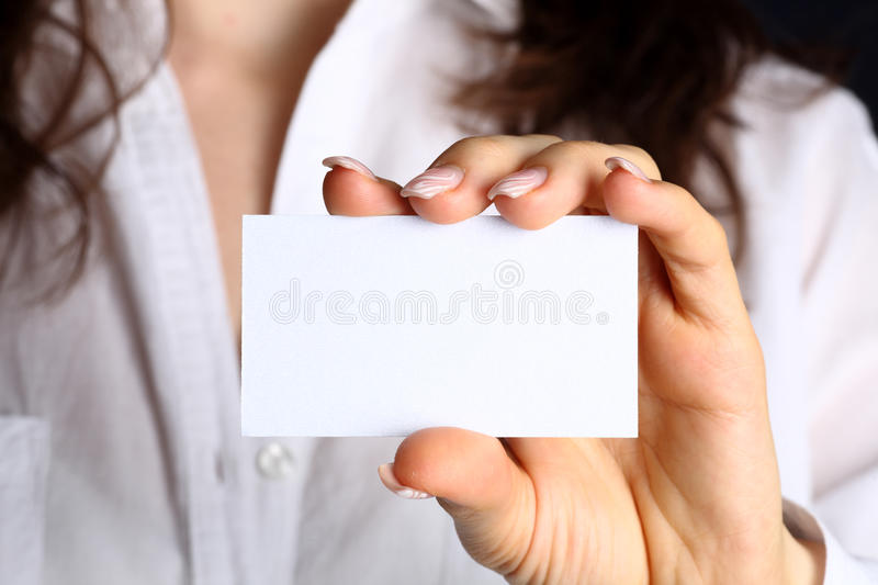 Business card. Blank of business card in woman hand stock images