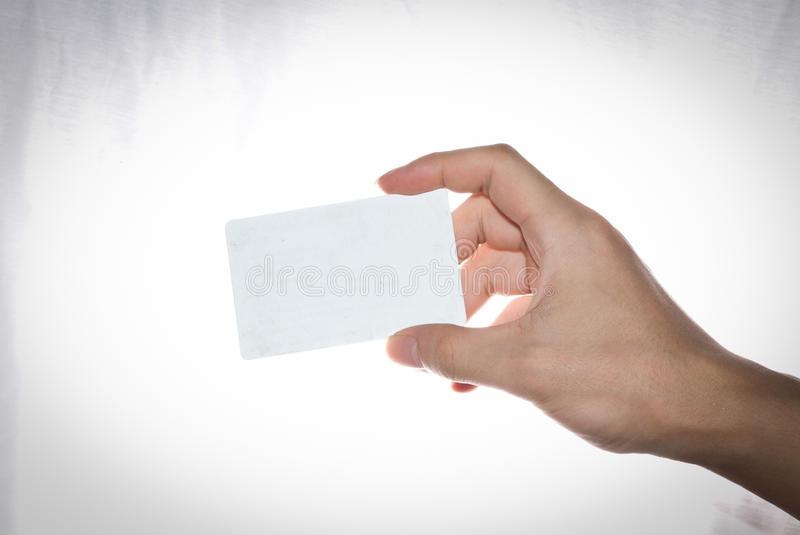 Business card. Hand holding an empty business card on white background royalty free stock photos