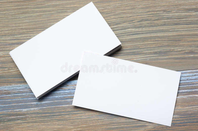 Business card blank over office table. Corporate stationery branding mock-up stock photos