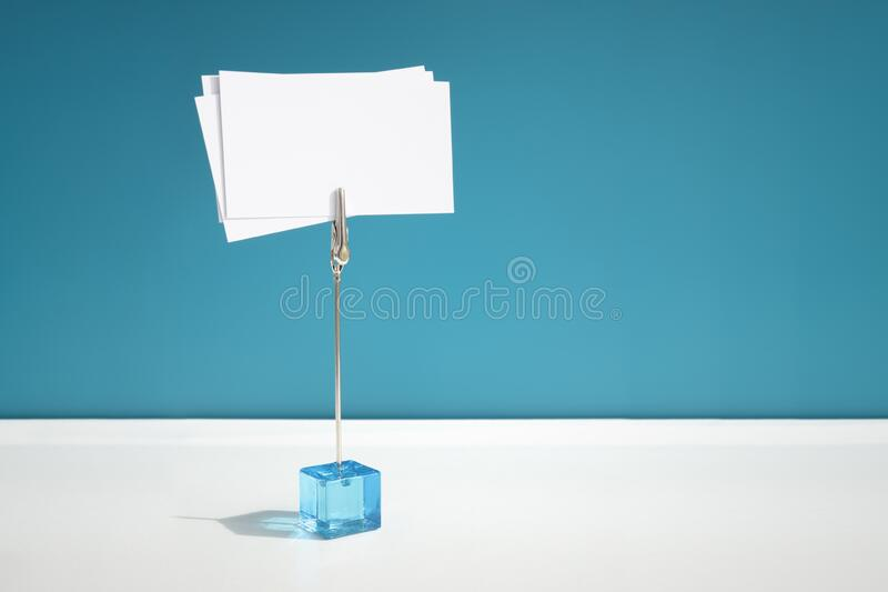 Business card blank sign on blue card holder stock image