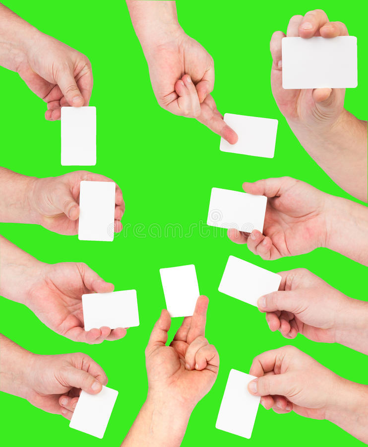 Business card in hand. On green background many hands royalty free stock images