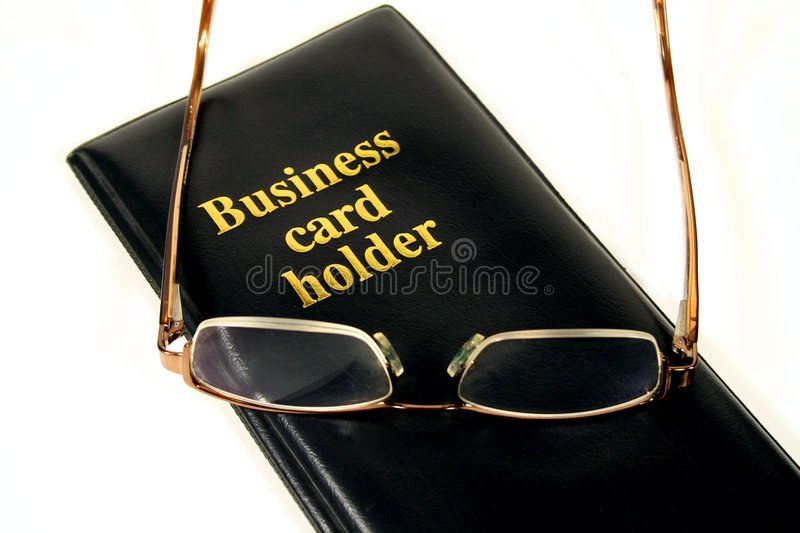 Business Card Holder. With glasses on top royalty free stock photo